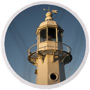 Mevagissey Lighthouse In The Evening Round Beach Towel