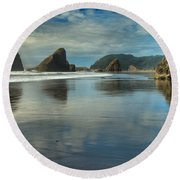 Meyers Creek Sea Stack Blues Round Beach Towel by Adam Jewell