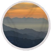 Mists In The Mountains At Sunset Round Beach Towel