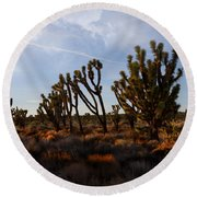 Mojave Desert Joshua Tree With Ravens Round Beach Towel