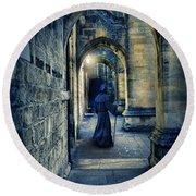 Monk In A Dark Corridor Round Beach Towel