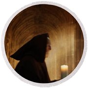 Monk With Candle In Cathedral Round Beach Towel