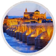 Mosque-cathedral And The Roman Bridge In Cordoba Round Beach Towel