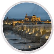 Mosque Cathedral Of Cordoba Also Called The Mezquita And Roman Bridge Round Beach Towel