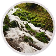 Mossy River Flowing. Round Beach Towel