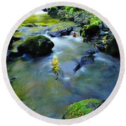 Mossy Rocks And Moving Water  Round Beach Towel