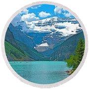 Mount Victoria Rises Above Lake Louise In Banff Np-alberta Round Beach Towel