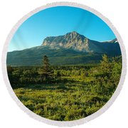 Mountains Of Many Glacier Round Beach Towel