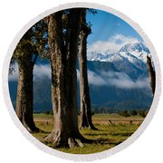 Mt Cook Through Trees Round Beach Towel