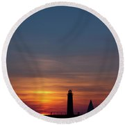 Muskegon Lighthouse Silhouetted At Sunset With A Sailboat In The Round Beach Towel