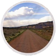 Red Road From The Benedictine Abbey Of Christ In The Desert New Mexico  Round Beach Towel