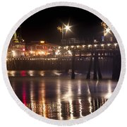 Night On Santa Monica Beach Pier With Bright Colorful Lights Reflecting On The Ocean And Sand Fine A Round Beach Towel