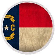 North Carolina State Flag Art On Worn Canvas Round Beach Towel by Design Turnpike