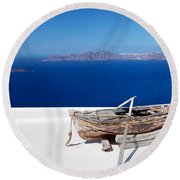 Old Boat On The Roof Of The Building On Santorini Greece Round Beach Towel
