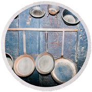Old Kitchen Utensils On Soot-black Wall Round Beach Towel