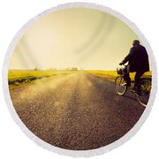 Old Man Riding A Bike To Sunny Sunset Sky Round Beach Towel