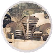 Old Plymouth Classic Car In The Snow Round Beach Towel
