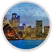Opera House And Buildings Lit Round Beach Towel