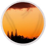 Orange Sunset And Silhouettes Of Norfolk Pines Round Beach Towel