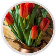 Orange Tulips In Copper Pitcher Round Beach Towel