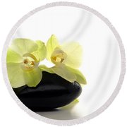 Orchid Flowers On Polished Stone Round Beach Towel by Olivier Le Queinec