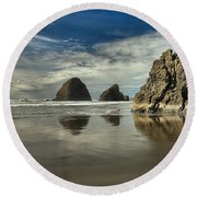 Oregon Sea Stack Reflections Round Beach Towel by Adam Jewell
