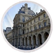 Ornate Architectural Artwork On The Buildings Of The Musee Du Louvre In Paris France Round Beach Towel