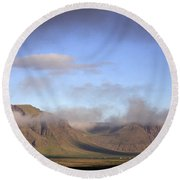 Panoramic View Of The Mountains Lit By The Sun Round Beach Towel