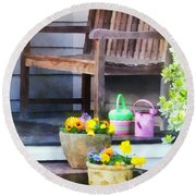 Pansies And Watering Cans On Steps Round Beach Towel