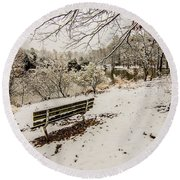 Park Bench In The Snow Covered Park Overlooking Lake Round Beach Towel