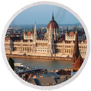 Parliament Building In Budapest At Sunset Round Beach Towel