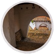 Passageway In Colonial Town Round Beach Towel