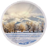 Pasture Land Covered In Snow With Taos Round Beach Towel