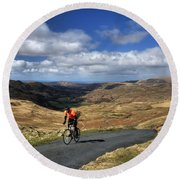 Pedalling The Pass Round Beach Towel