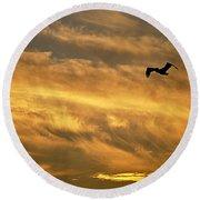 Pelican Against The Golden Sky Round Beach Towel