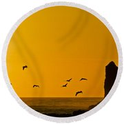 Pelicans On The Wing II Round Beach Towel