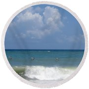 Pelicans Over The Ocean Round Beach Towel