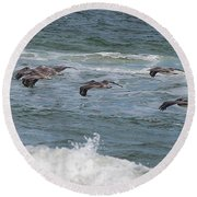 Pelicans Over The Water Round Beach Towel