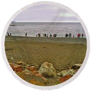 People Lined Up To Catch Capelin On The Shore Of Middle Cove-nl Round Beach Towel