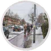 People On Bicycles In Winter Round Beach Towel