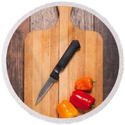 Peppers And Knife On Cutting Board Round Beach Towel