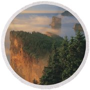 Perce Rock And The Three Sisters In Fog Round Beach Towel