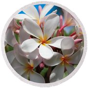 Plumerias Under A Blue Sky Round Beach Towel
