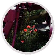 Poppies Growing Amongst Farm Machinery In A Farmyard Near Pocklington Yorkshire Wolds East Yorkshire Round Beach Towel