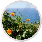Poppies On The Pacific Round Beach Towel