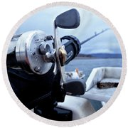 Portrait  Of Fishing Reel On Boat While Round Beach Towel
