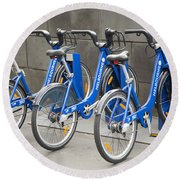 Public Shared Bicycles In Melbourne Australia Round Beach Towel