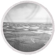 Puddles Of Ocean Left Behind Round Beach Towel