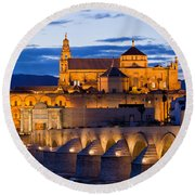 Puente Romano And Mezquita At Twilight In Cordoba Round Beach Towel