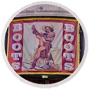 Pulling On Her Boots In Nashville Round Beach Towel